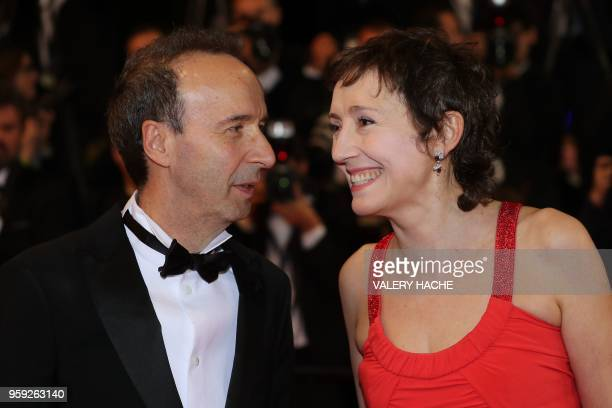 TOPSHOT Italian actress and producer Nicoletta Braschi and her husband Italian actor and director Roberto Benigni arrive on May 16 2018 for the...