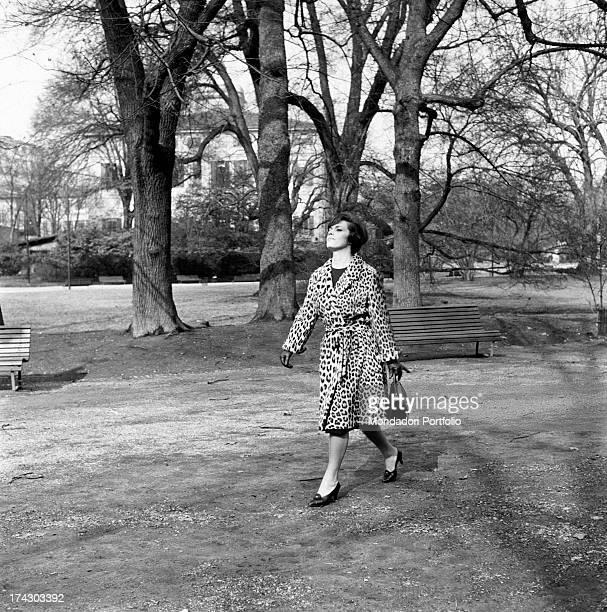 Italian actress and screenwriter Franca Valeri walking down a lane of Parco Sempione Milan 1950s