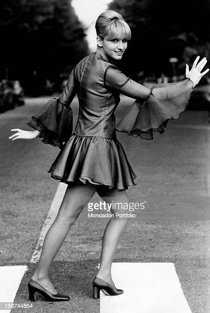 Italian actress and singer Carmen Villani crossing the road on a pedestrian crossing Milan 1970s