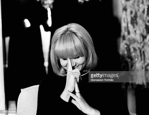 Italian actress and singer Carmen Villani laughing and covering her face with her hands Milan 1970s