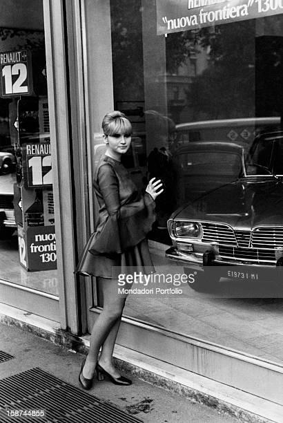 Italian actress and singer Carmen Villani looking at a shop window Milan 1970s