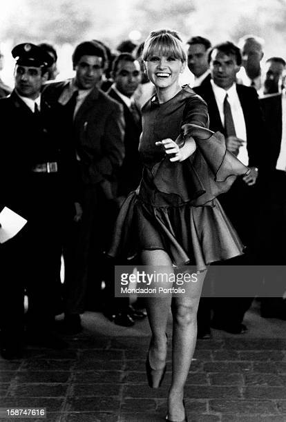 Italian actress and singer Carmen Villani running and smiling Milan 1970s