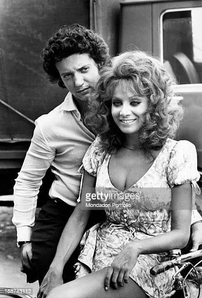 Italian actress and singer Maria Grazia Buccella sitting next to her fiancée the film producer Vittorio Cecchi Gori Rome 1970s