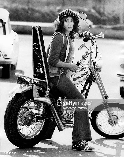 Italian actress and singer Maria Grazia Buccella sitting on a motorcycle Rome 1970s