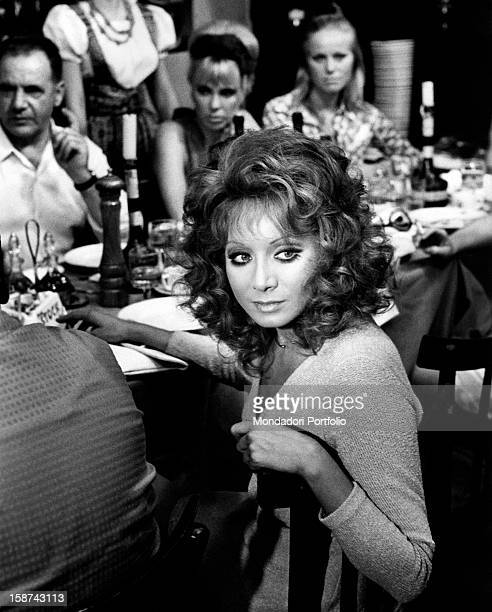 Italian actress and singer Maria Grazia Buccella sitting on the set of the film Basta Guardarla Rome 1970s