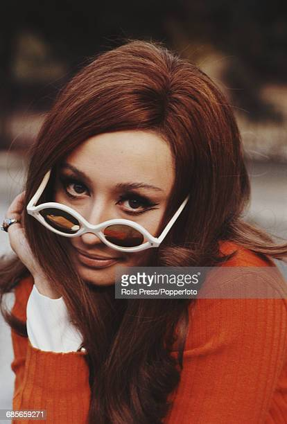 Italian actress and singer Raffaella Carra posed wearing a pair of white rimmed sunglasses at Rome zoo in Italy on 31st October 1968