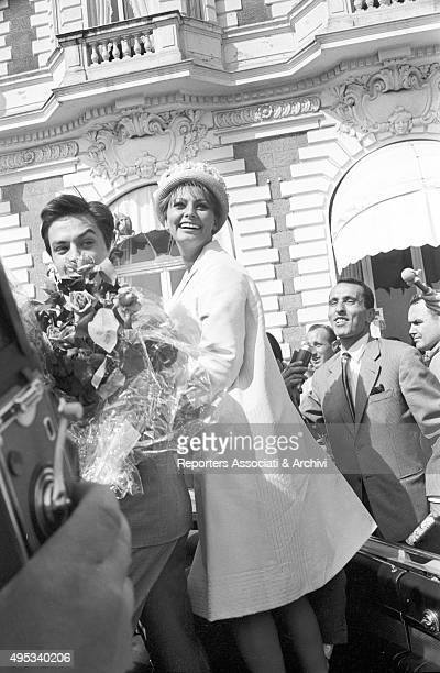 Italian actress and singer Sophia Loren and French actor director and singer Alain Delon greeting their fans from the car The actors will attend the...