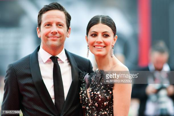 Italian actress and sponsor of the Festival Alessandra Mastronardi and her boyfriend Scottish actor Ross McCall pose as they arrive for the opening...