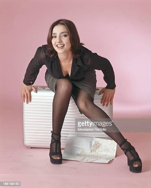 Italian actress and TV presenter Ambra Angiolini smiling on a photo set Italy 1996