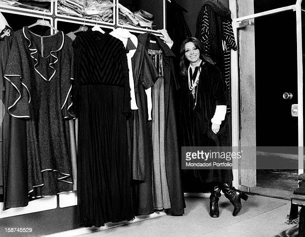Italian actress and TV presenter Laura Efrikian smiling and leaning on a wardrobe. Rome, 1970s
