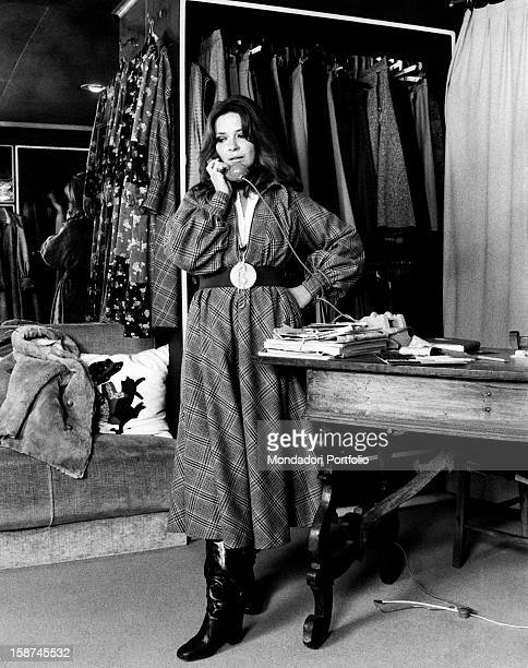 Italian actress and TV presenter Laura Efrikian speaking over the phone. Rome, 1970s