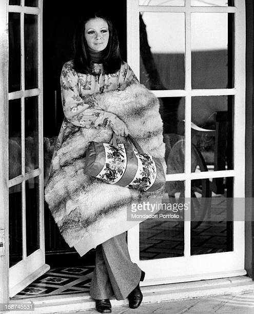 Italian actress and TV presenter Laura Efrikian wearing a fur stole. Rome, 1970s
