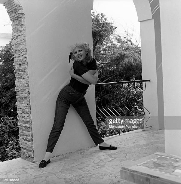 Italian actress and TV presenter Sandra Milo posing with her legs open wide on her terrace at home Fregene July 1964