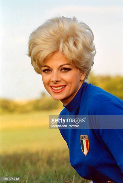 Italian actress and TV presenter Sandra Milo smiling in a tshirt of Italian national football team Rome 1966