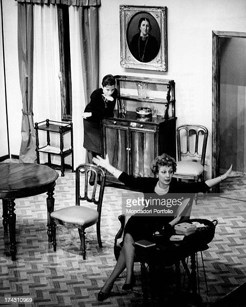 Italian actress Andreina Pagnani caressing Italian actor Elio Zamuto on his face in the theatrical drama Quaderno proibito Rome December 1961