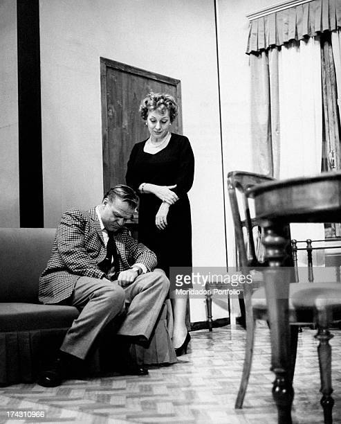 Italian actress Andreina Pagnani receiving in her office Italian actor Mario Chiocchio in the theatrical drama Quaderno proibito Rome December 1961