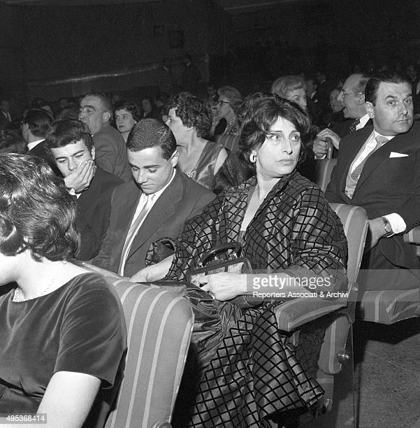 Italian actress Anna Magnani attending a film première with her son Luca and a friend Rome 1959