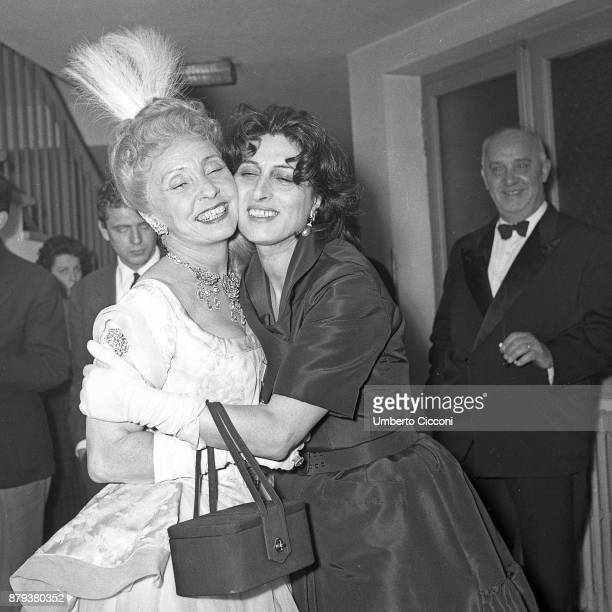Italian actress Anna Magnani hugs Madaleine Arnaud at the Eliseo theatre for 17thcentury comedy of manners 'The Misanthrope' Rome 1958
