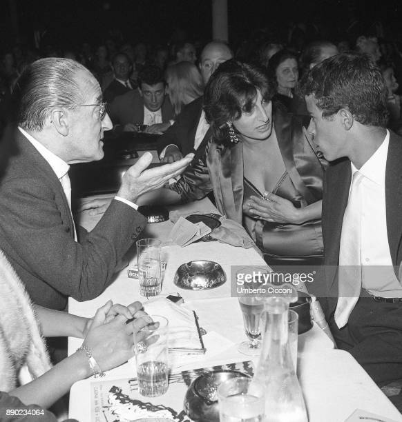Italian actress Anna Magnani is with her son Luca and Italian comedian Totò at 'Casina delle Rose' for the Italian film award 'Nastri D'Argento' Rome...