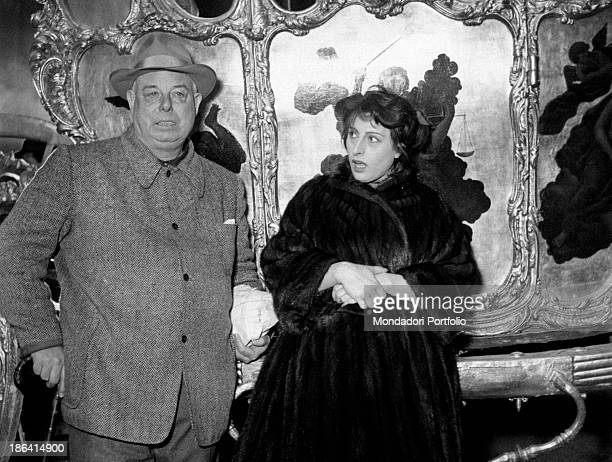 Italian actress Anna Magnani looking astonished at French director Jean Renoir on the set of The golden coach Rome 1952