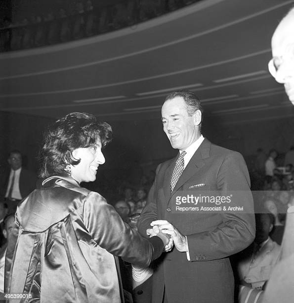 Italian actress Anna Magnani shaking American actor Henry Fonda's hand at Harry Belafonte's concert at Sistina Theatre Rome 2nd October 1958