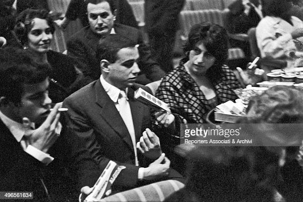 Italian actress Anna Magnani sitting in the stalls at Sistina theatre beside her son Luca Magnani for Italianborn French singer Yves Montand 's...