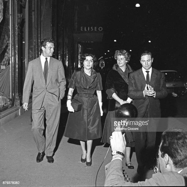 Italian actress Anna Magnani with actor Anthony Franciosa and two more people outside the Eliseo Theatre Rome 1958