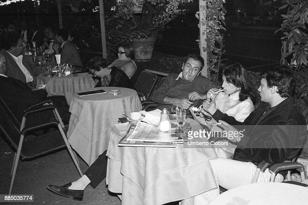 Italian actress Anna Magnani with friends at the coffee bar in Via Veneto Rome 1966