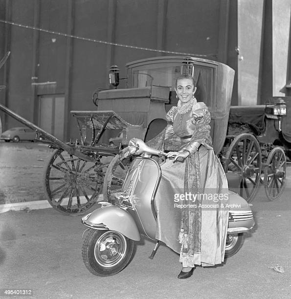 Italian actress Anna Maria Ferrero riding a Vespa in stage costume on the set of the film Kean Genius or Scoundrel Rome 1955