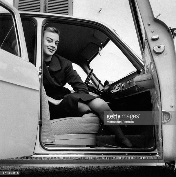 Italian actress Anna Maria Ferrero sitting on board an Alfa Romeo Giulietta Milan April 1955