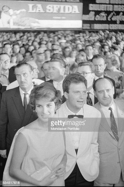 Italian actress Antonella Lualdi and her husband and Italian actor Franco Interlenghi surrounded by the crowd during the 19th Venice International...