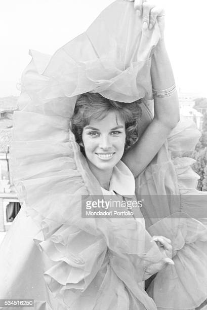Italian actress Antonella Lualdi joking with her evening dress during the 19th Venice International Film Festival Venice August 1958