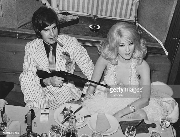 Italian actress Antonella Lualdi with her husband Franco Interlenghi in costume at a gangster party in Cortina February 1968