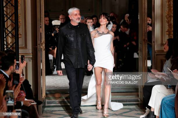 Italian actress Asia Argento and Italian fashion designer Antonio Grimaldi acknowledge the audience at the end of the 2019 SpringSummer Haute Couture...