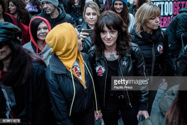 Italian actress Asia Argento and US singer and actress Rose McGowan who both accuse Harvey Weinstein of sexual assault take part in a march organised...