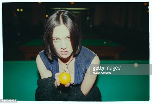 Italian actress Asia Argento holds a yellow pool ball on the set of the movie B Monkey This movie directed by Michael Radford is about a quiet man...