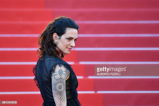 Italian actress Asia Argento poses as she arrives on May 17 2017 for the screening of the film 'Ismael's Ghosts' during the opening ceremony of the...