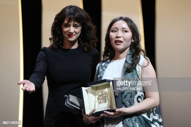 Italian actress Asia Argento presents Kazakh actress Samal Yeslyamova with the Best Actress Prize for her part in Ayka on May 19 2018 during the...