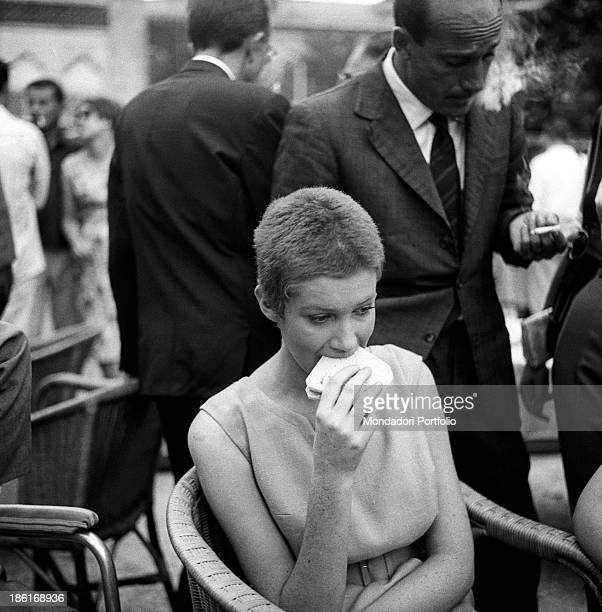 Italian actress Carla Gravina eating a sandwich at the International Film Festival. She shaved her hair for the film Five Branded Women. Venice,...
