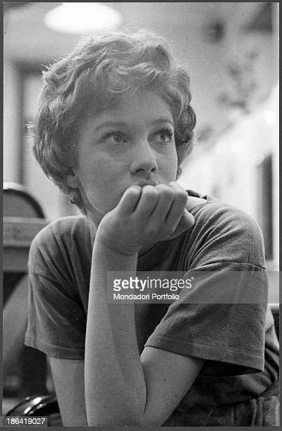 Italian actress Carla Gravina sitting with her hand under her chin Rome 1959