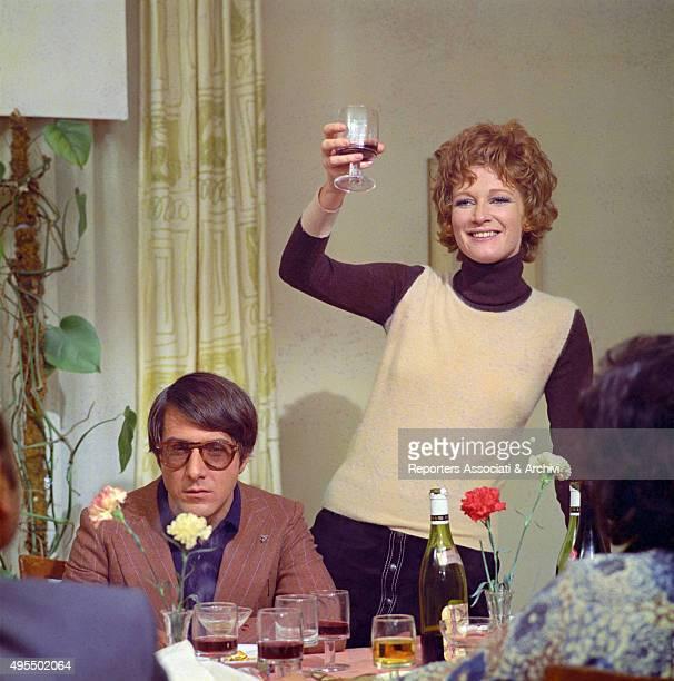 Italian actress Carla Gravina toasting with American actor Dustin Hoffman in the film Alfredo Alfredo 1972