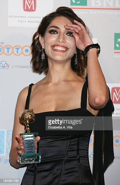 Italian actress Caterina Murino shows her award for the best European actress during the 2008 Globo D`Oro Awards held Villa Massimo on July 2 2008 in...