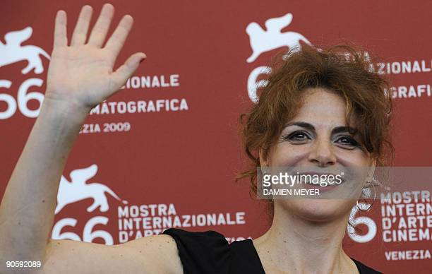 "Italian actress Caterina Varzi poses during the photocall of ""Hotel Courbet"" at the Venice film festival on September 11, 2009. ""Hotel Courbet"" is..."