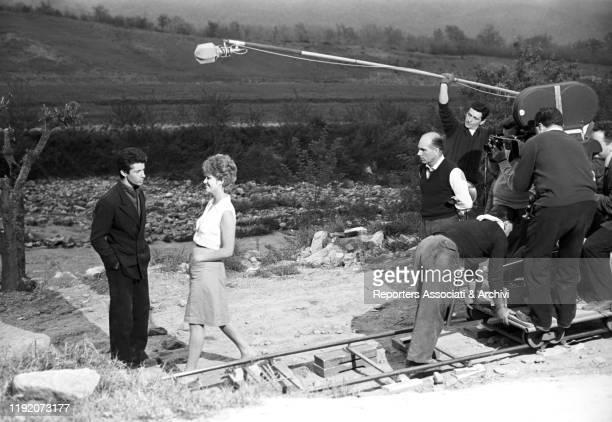 Italian actress Claudia Cardinale and American actor Georges Chakiris preparing a scene on the set of La Ragazza di Bube. Italy, 1963