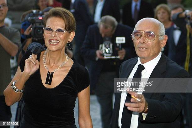 Italian actress Claudia Cardinale and her partner Pasquale Squitieri smiling to the photographers at their arrival at the opening of the exhibition...