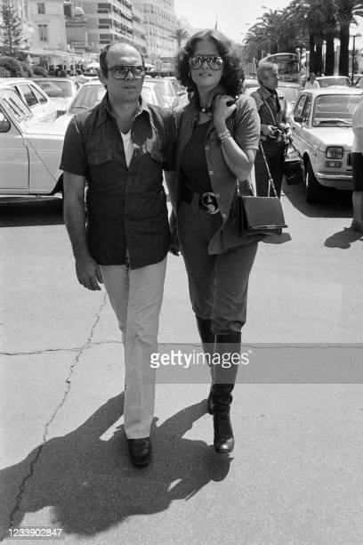 Italian actress Claudia Cardinale and Italian director Pasquale Squitieri walk on the Croisette during the Cannes Film Festival in Cannes, southern...