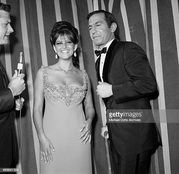 Italian actress Claudia Cardinale attends a show with actor Ben Gazzara in Los Angeles California