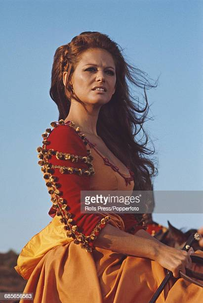 Italian actress Claudia Cardinale, dressed in character as Theresa, pictured on horseback on the set of the film 'The Adventures of Gerard' in Italy...