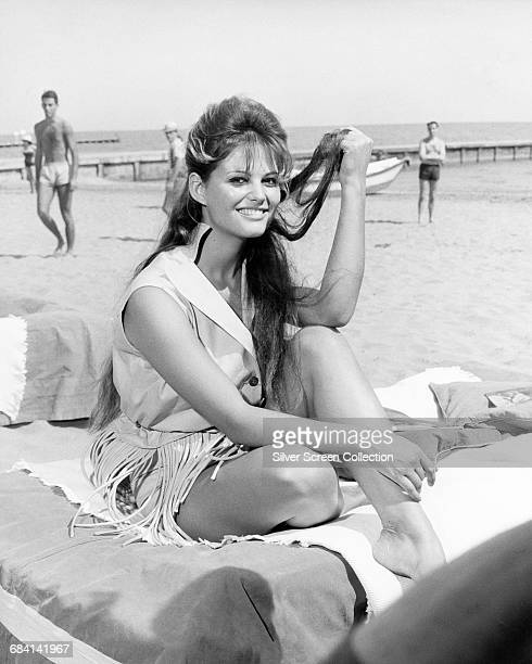 Italian actress Claudia Cardinale on the beach, circa 1960.