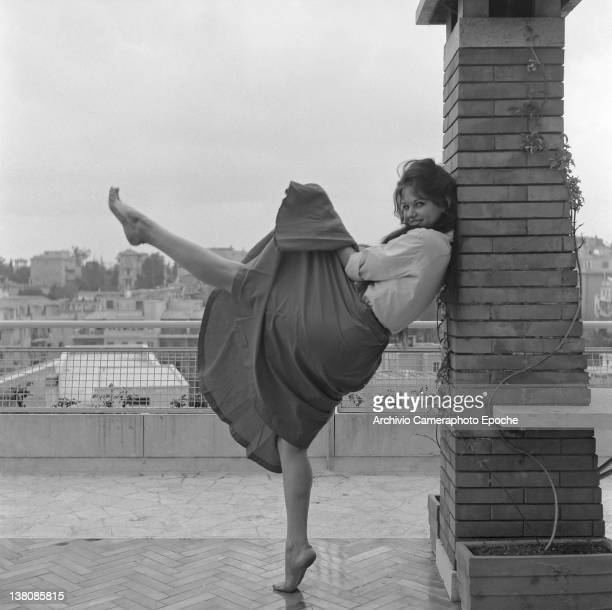Italian actress Claudia Cardinale portrayed while dancing on a terrace, Rome, 1959.